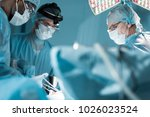 multicultural surgeons in... | Shutterstock . vector #1026023524