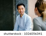 a young chinese man who is... | Shutterstock . vector #1026056341