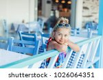 portrait of happy curly pretty... | Shutterstock . vector #1026064351