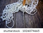 tangles of rope on a weathered... | Shutterstock . vector #1026074665