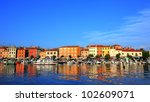 peaceful harbor reflection at old port of Rovinj, Croatia - stock photo