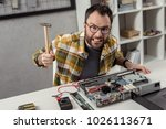 angry repairman with hammer in... | Shutterstock . vector #1026113671