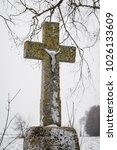 old stone made cross with jesus ... | Shutterstock . vector #1026133609