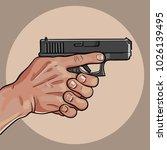 hand with gun. gun control... | Shutterstock .eps vector #1026139495