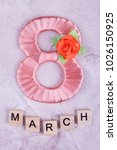 Small photo of Peach eight and word March. Eight, word March on concrete background. Handmade gift on woman's day