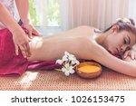 woman receiving scrub massage... | Shutterstock . vector #1026153475