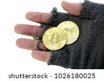 Small photo of concept of the risk of virtual currency markets with hand of poor man holding two golden BitCoin coins
