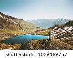 backpacker woman enjoying lake...   Shutterstock . vector #1026189757
