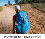 woman walking on camino de... | Shutterstock . vector #1026194404