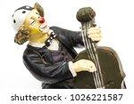 old figurine on white... | Shutterstock . vector #1026221587