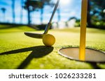 mini golf yellow ball with a... | Shutterstock . vector #1026233281