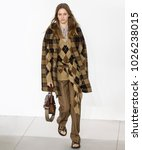 Small photo of NEW YORK, NY - February 14, 2018: Sarah Dahl walks the runway at the Michael Kors Fall Winter 2018 fashion show during New York Fashion Week