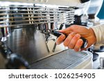 barista making coffee using a... | Shutterstock . vector #1026254905