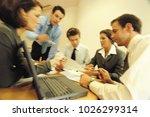 a business meeting | Shutterstock . vector #1026299314