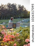 Small photo of Kyiv, Ukraine - 05/19/2015: Artists Sketching in the garden. Male artist on painting on canvas in outdoor