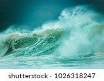 huge waves crashing on a beach...   Shutterstock . vector #1026318247