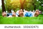children's feet  on grass.... | Shutterstock . vector #102632471
