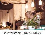 beautiful girl sitting in... | Shutterstock . vector #1026343699