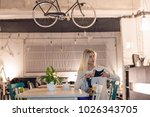 beautiful girl in cafeteria... | Shutterstock . vector #1026343705
