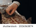 priest holding wedding ring for ... | Shutterstock . vector #1026363874