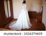 wedding white dress of the bride | Shutterstock . vector #1026374605