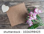 notepad with white heart on... | Shutterstock . vector #1026398425