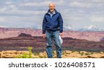 backpacker hiker man rests... | Shutterstock . vector #1026408571