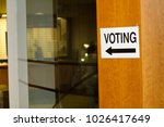 polling station voting sign | Shutterstock . vector #1026417649