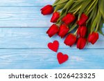red tulips and two wooden... | Shutterstock . vector #1026423325