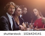 poker players drink champagne... | Shutterstock . vector #1026424141