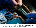 technician is open a cover and... | Shutterstock . vector #1026487525