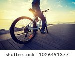 cyclist riding bike in the... | Shutterstock . vector #1026491377