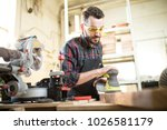 young caucasian carpenter  in ... | Shutterstock . vector #1026581179