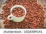 white coffee cup in a pile of... | Shutterstock . vector #1026589141