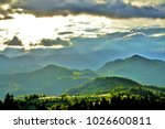 sun rays among clouds in the... | Shutterstock . vector #1026600811