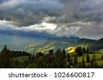sun rays among clouds in the... | Shutterstock . vector #1026600817