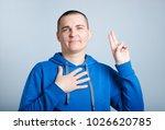 handsome man gives an oath ... | Shutterstock . vector #1026620785