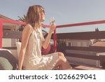 girl drinking wine on a terrace ... | Shutterstock . vector #1026629041