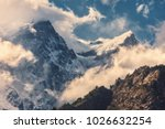 high mountains with snowy peaks ... | Shutterstock . vector #1026632254