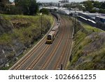 Small photo of Taringa, Brisbane, Australia - February 2018: Suburban electric train approaching Taringa station
