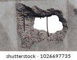 the hole in the concrete wall... | Shutterstock . vector #1026697735