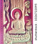 Small photo of Carving on the church door in Wat Sawaniweth Thailand.Siddhartha became the enlightened one, the All-Knowing one, he became Gotama the Buddha.