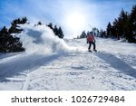 very fast skiier goind downhill ... | Shutterstock . vector #1026729484
