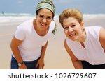 portrait of two beautiful 45... | Shutterstock . vector #1026729607
