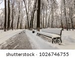 winter park with trees covered... | Shutterstock . vector #1026746755