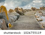 rocky path to clouds in norway  ...   Shutterstock . vector #1026755119