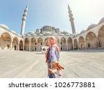 follow me. a muslim woman in a... | Shutterstock . vector #1026773881