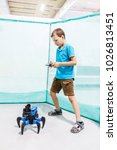 school boy playing with robot...   Shutterstock . vector #1026813451