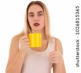 young cute woman drinks coffee... | Shutterstock . vector #1026815365