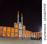 Small photo of YAZD, IRAN - MAY 5, 2015: People praying evening prayer in front of the Amir Chakhmaq Complex in old city by night. Long exposition and wide panorama.